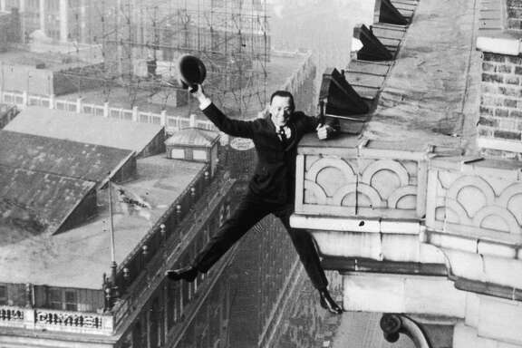 Harry Gardiner hanging from the 24th story of the Hotel McAlpin, Broadway, New York, 1925. (Photo by Hulton Archive/Getty Images)