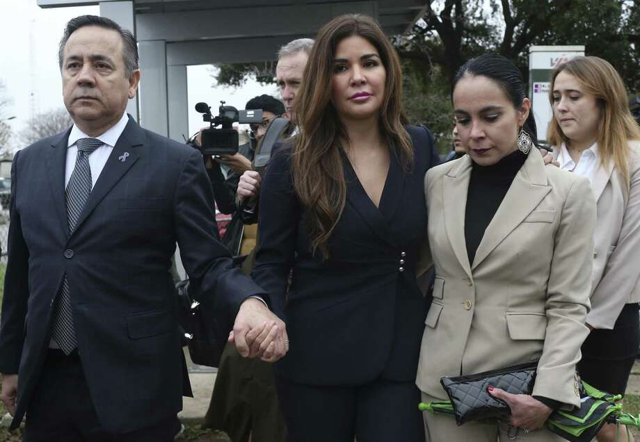 A federal judge this week issued an order preventing state Sen. Carlos Uresti and his wife, Lleanna (center), from dividing their property in any divorce proceeding. She filed for divorce last Friday, about a week after a federal jury found him guilty of 11 felony charges. Photo: Jerry Lara /San Antonio Express-News / 2018 San Antonio Express-News