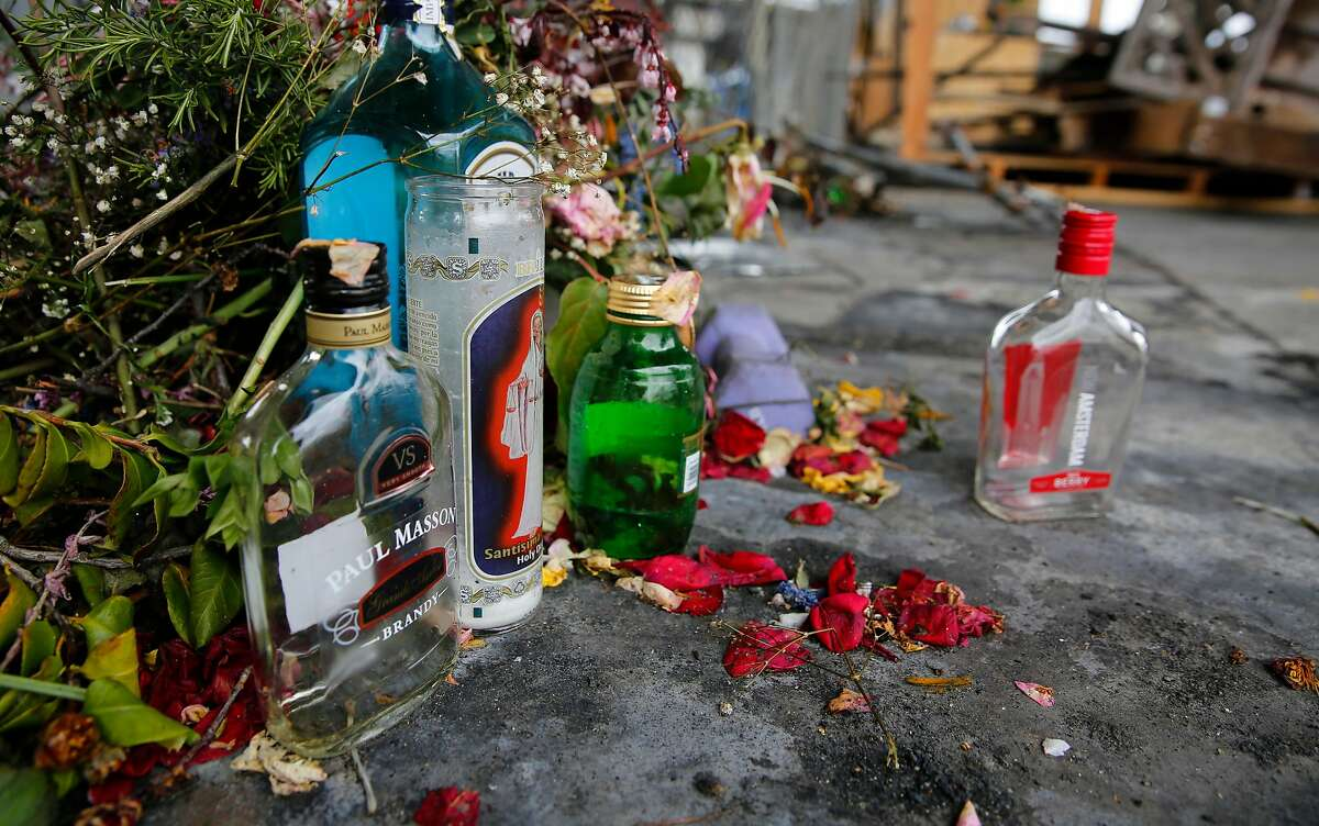 A makeshift memorial to a homeless man who was slain in Oakland.