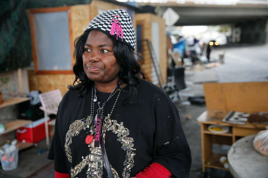 Danielle Golden, who is homeless, has seen several of her friends die while living homeless encampments under Highway 24 along Northgate Avenue in Oakland. Photo: Michael Macor, The Chronicle