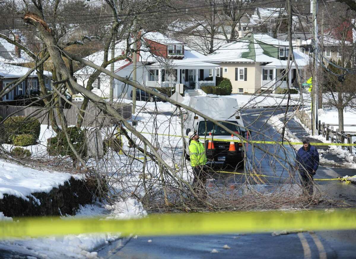 Crews remove trees and repair power lines on Strickland Road in the Cos Cob section of Greenwich, Conn. Thursday, March 8, 2018. The area received about eight inches of snow with strong winds Wednesday and crews spent Thursday removing fallen trees and restoring power to the community.