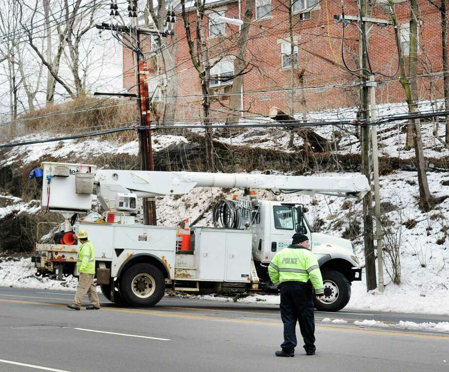 Utility crews begin work on the electric lines that have a tree resting on them on West Putnam Avenue in Greenwich, Conn., Thursday, March 8, during the aftermath of Wednesday's snowstorm. Photo: Bob Luckey Jr. / Hearst Connecticut Media / Greenwich Time