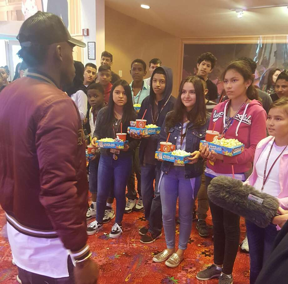 Dynamo forward Alberth Elis, nicknamed La Panterita, talks to students from Las Americas Newcomer School before a private screening of the Black Panther movie. Photo: Corey Roepken/Houston Chronicle