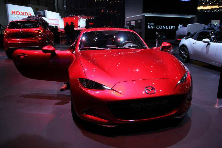Cars are displayed at the press days of 88th Geneva International Motor Show, which runs March 8-18 at Palexpo Exhibition Centre in Switzerland. Photo: Anadolu Agency/Getty Images