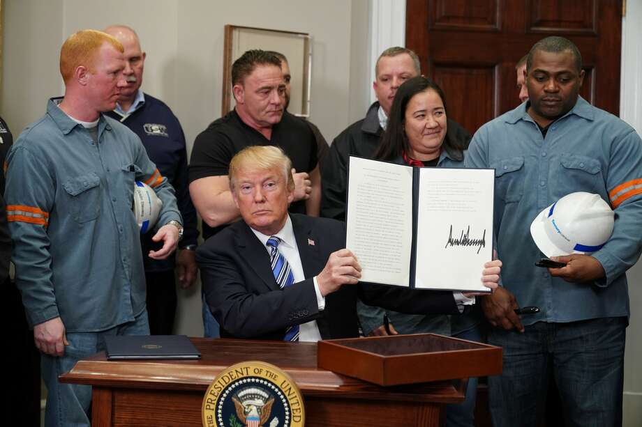 President Donald Trump signs Section 232 Proclamations on Steel and Aluminum Imports in the Oval Office of the White House on March 8, 2018, in Washington, DC. Photo: MANDEL NGAN/AFP/Getty Images