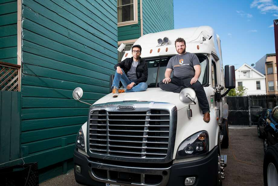 Starsky Robotics co-founders CEO Stefan Seltz-Axmacher (right) and CTO Kartik Tiwari sit on a semiautonomous truck's hood. Photo: Noah Berger, Special To The Chronicle