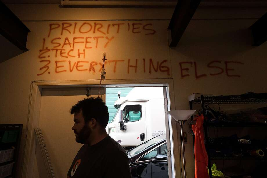 Starsky Robotics' guiding principles line a wall at the company's San Francisco headquarters.  The list was painted by CEO Seltz-Axmacher (center). Photo: Noah Berger, Special To The Chronicle