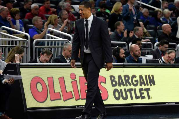 Connecticut Huskies head coach Kevin Ollie walks back to the bench in the second half in a first round game at the 2018 American Athletic Conference Men's Basketball Championship against SMU at Amway Center Thursday, March 8, 2018 in Orlando. SMU won, 80-73.