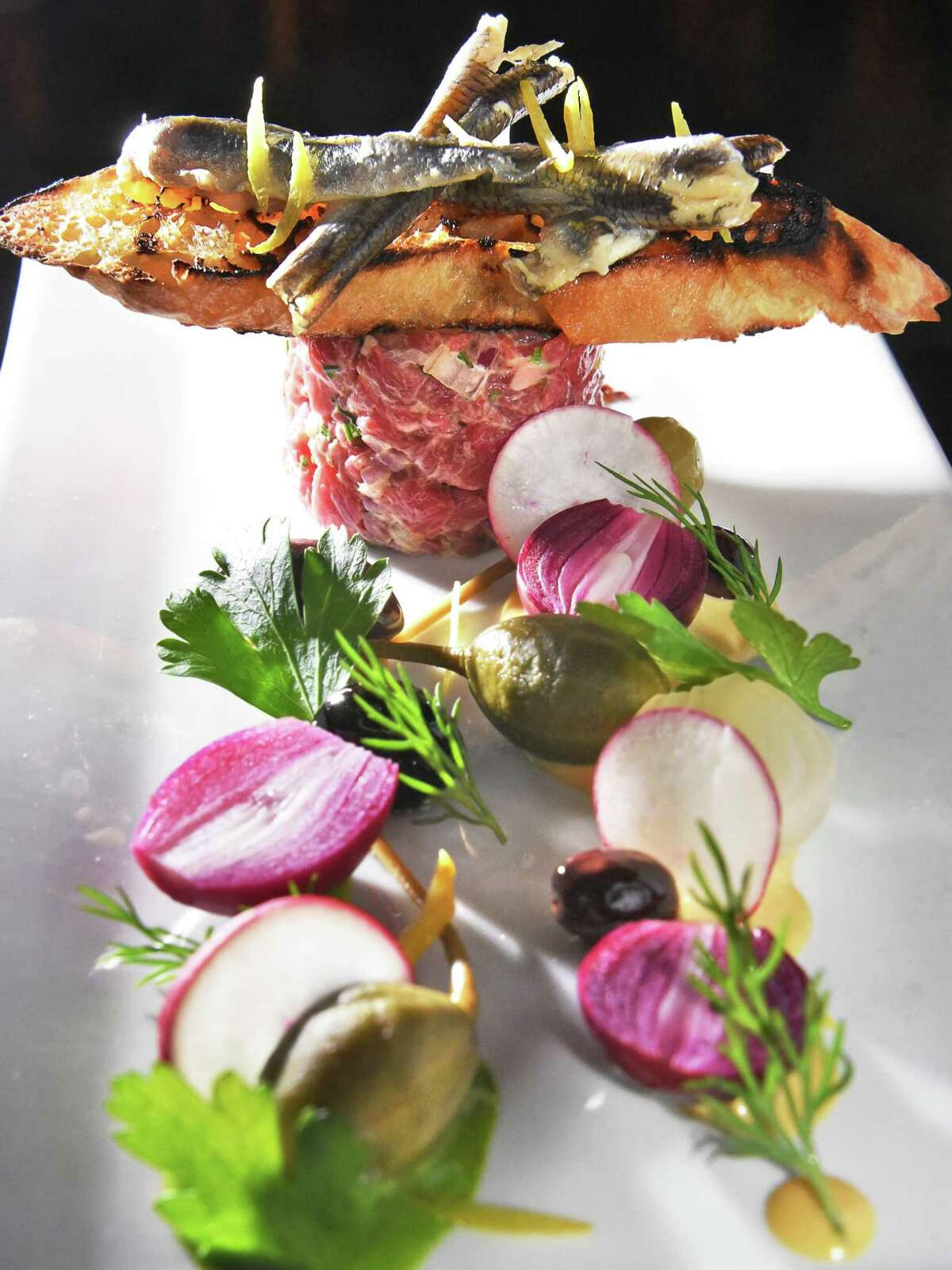 Beef tartare and boquerones at The Wine Bar on Broadway Friday March 2, 2018 in Saratoga Springs, NY. (John Carl D'Annibale/Times Union)