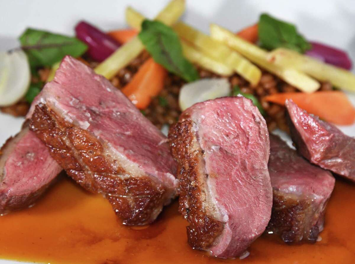 Pan roasted duck breast with wheat berries and beets at The Wine Bar on Broadway Friday March 2, 2018 in Saratoga Springs, NY. (John Carl D'Annibale/Times Union)
