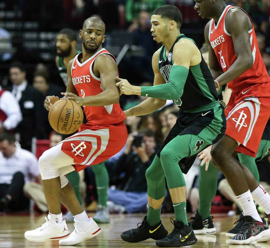 Houston Rockets guard Chris Paul (3) tries to past Boston Celtics forward Jayson Tatum (0) during the first quarter of a NBA game at the Toyota Center on Saturday, March 3, 2018, in Houston. ( Yi-Chin Lee / Houston Chronicle ) Photo: Yi-Chin Lee, Staff / © 2018 Houston Chronicle