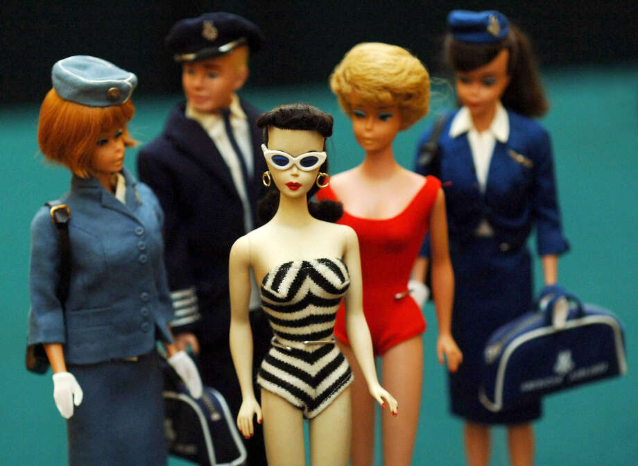 See how Barbie has changed after almost six decades of being on shelves. Photo: Fiona Hanson - PA Images/PA Images Via Getty Images