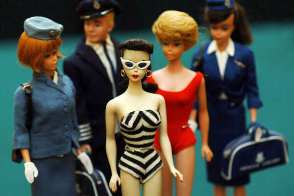 One of the Barbie number 1's (centre), the first Barbie doll model created in 1959 by Ruth Handler, co-founder of Mattel, at Christie's in London where she will be auctioned, estimated at 700-1,200, on September 26th with 4000 Barbie dolls from the Ietje Raebel and Marina Collection, one of the most complete collections in existence.   (Photo by Fiona Hanson - PA Images/PA Images via Getty Images)