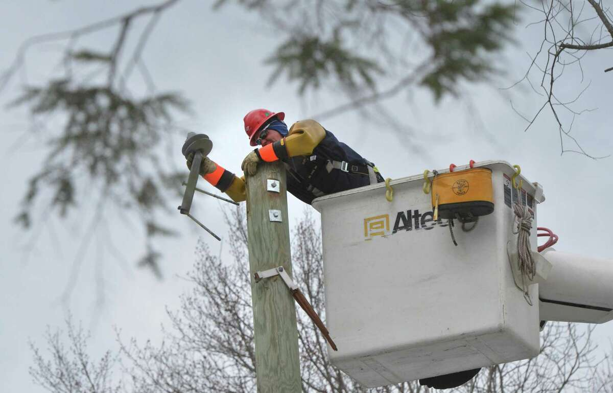 Eversource crews work at restoring service along Westport Road in Wilton after tree damage had been cleared.