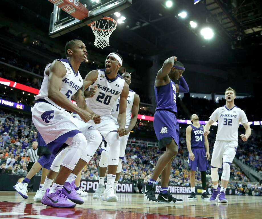 Kansas State's Barry Brown (5) and Xavier Sneed (20) celebrate after a basket during the second half of an NCAA college basketball game against TCU in the Big 12 men's tournament Thursday, March 8, 2018, in Kansas City, Mo. Kansas State won 66-64 in overtime. (AP Photo/Charlie Riedel) Photo: Charlie Riedel, Associated Press / Copyright 2018 The Associated Press. All rights reserved.