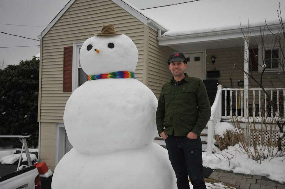 Torrington resident Brandon Blatchley used Wednesday's snowstorm to fashion a snowman, which stood sentry over Eggleston Street Thursday afternoon as flurries began to fall. Photo: Ben Lambert / Hearst Connecticut Media