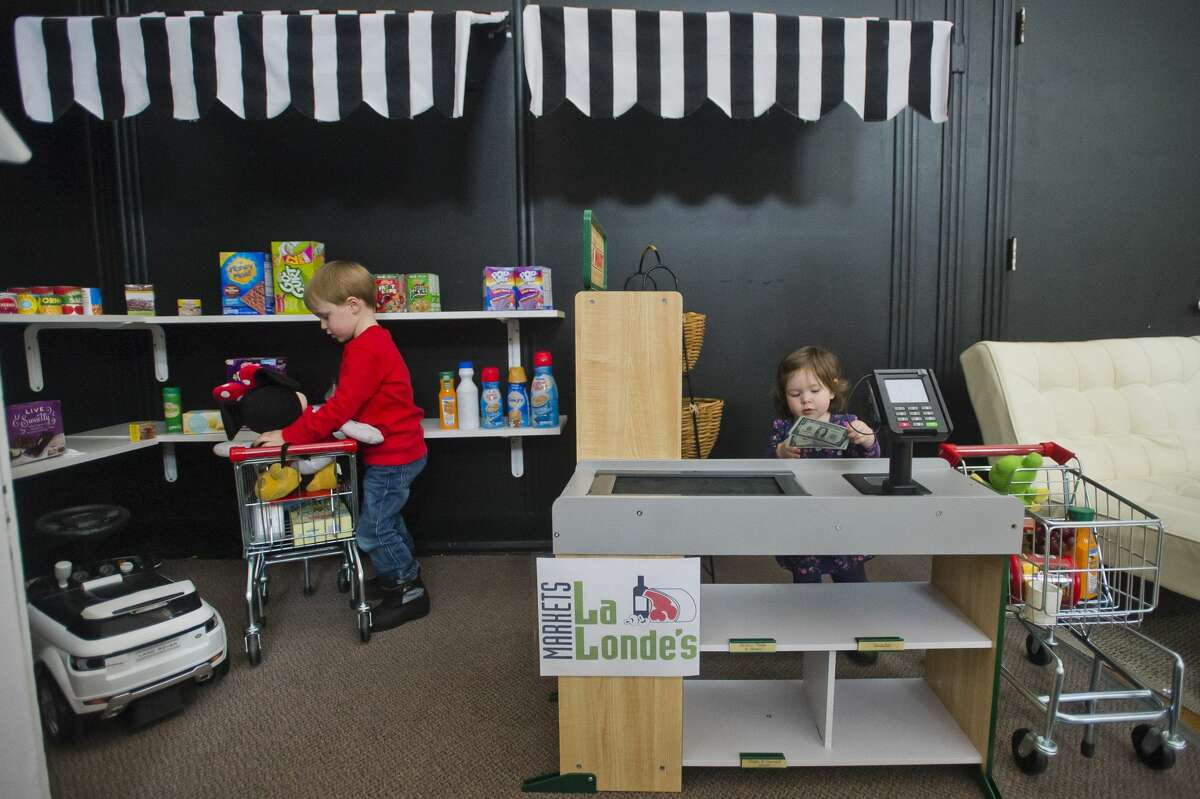 Kids play in the miniature LaLonde's at Little Midland, a miniature play city modeled after local businesses in Midland, on Wednesday, March 7, 2018. Little Midland is located on the second floor of Ashman Plaza. (Katy Kildee/kkildee@mdn.net)
