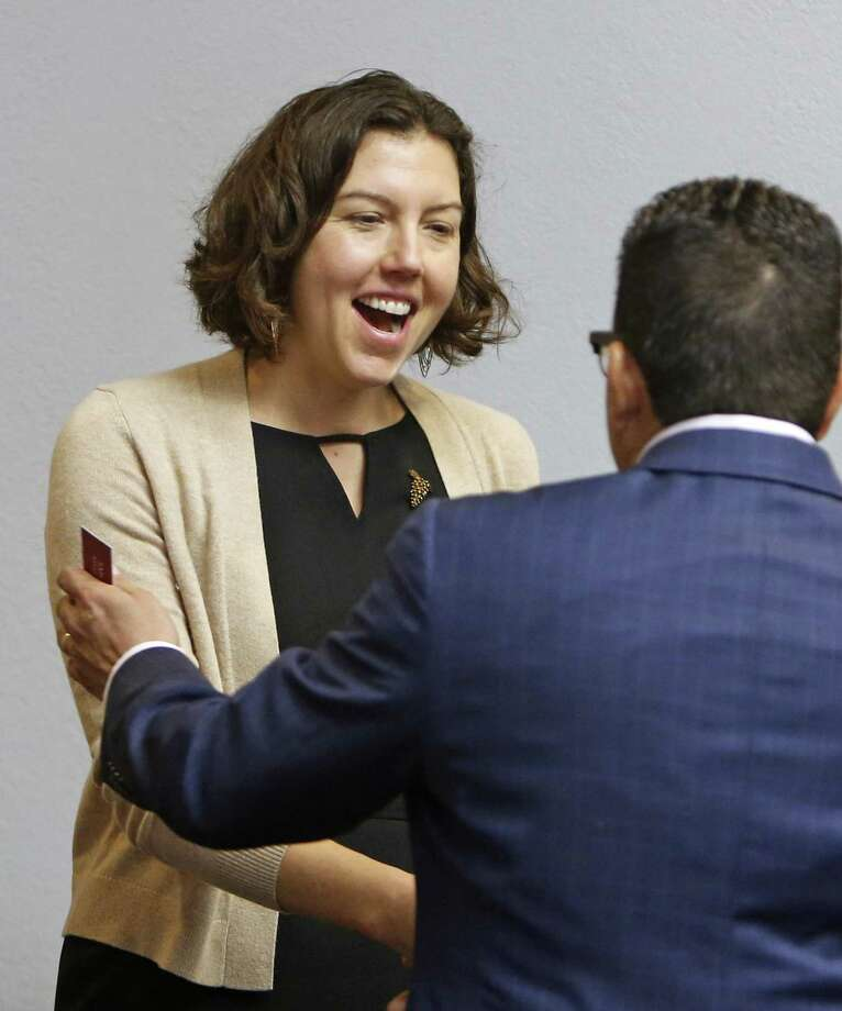 Amy Hardberger greets Richard Perez, president and CEO of the San Antonio Chamber of Commerce, at the City Council Governance Committee meeting on Feb. 28. Her nomination to the San Antonio Water System board of trustees was forwarded by the committee and approved Thursday after a heated council discussion. Photo: Ronald Cortes /For The San Antonio Express-News / 2018 Ronald Cortes