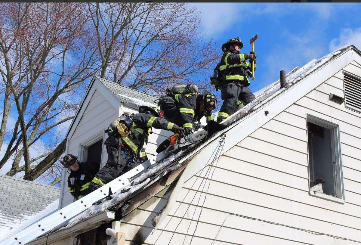 Firefighters work a blaze in Riverside Thursday morning.