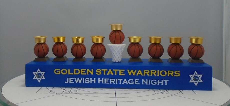 Nearly 2,000 Golden State Warriors menorahs are being recalled because their basketball-shaped candleholders pose a fire risk. Photo: CPSC