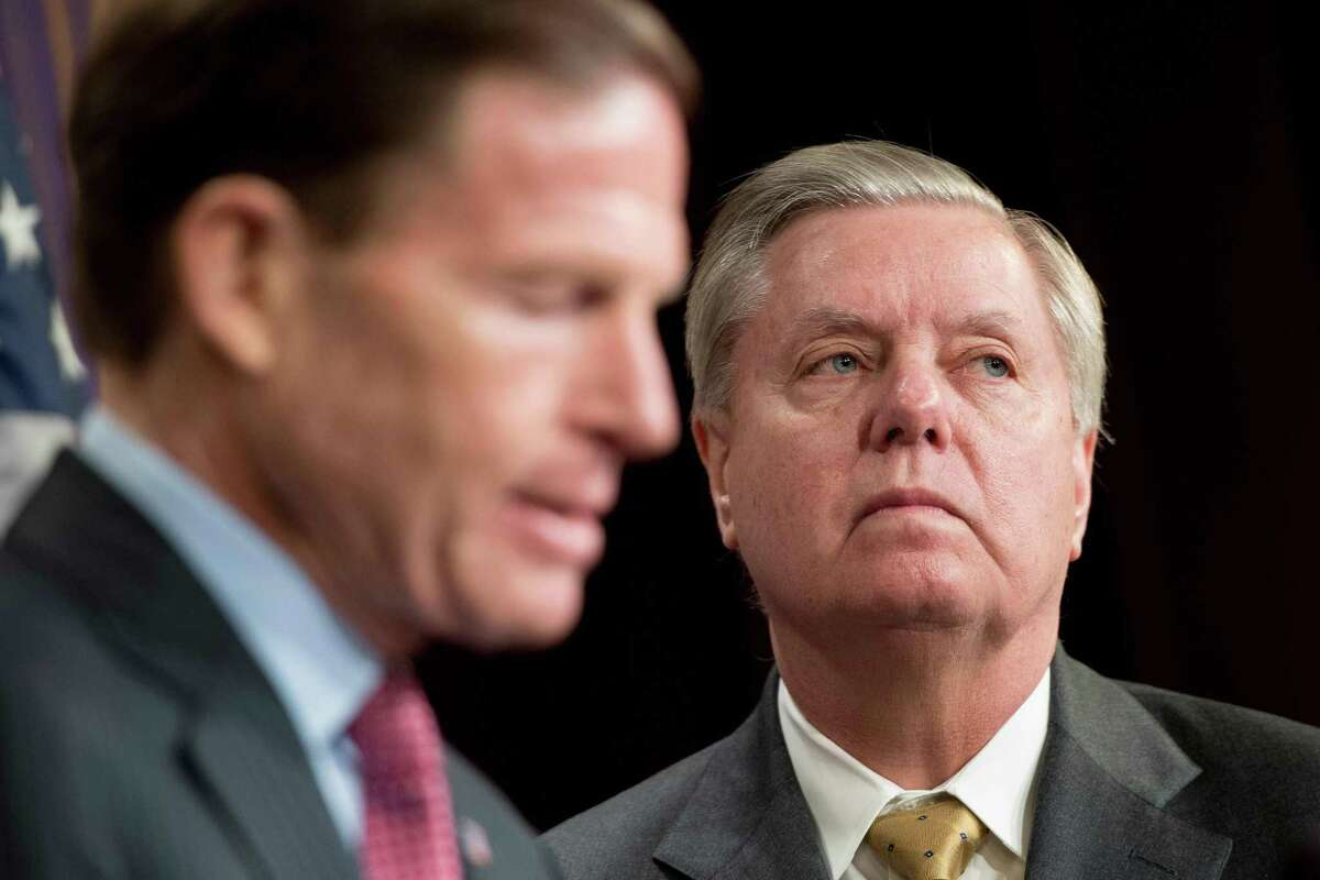 US Senator Lindsey Graham (R), R-South Carolina, and US Senator Richard Blumenthal (L), D-Connecticut, explain Extreme Risk Protection Orders on Capitol Hill in Washington, DC, on March 8, 2018.