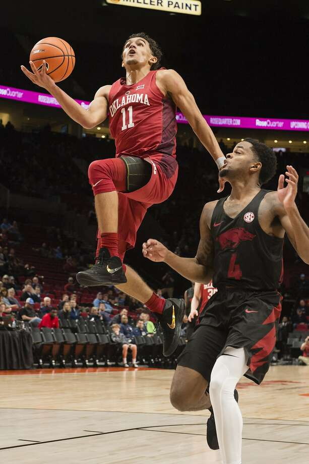 Oklahoma guard Trae Young is soaring high in his freshman year, leading the nation in scoring (27.5 points per game) and assists (8.9) during the regular season. Photo: Troy Wayrynen, Associated Press
