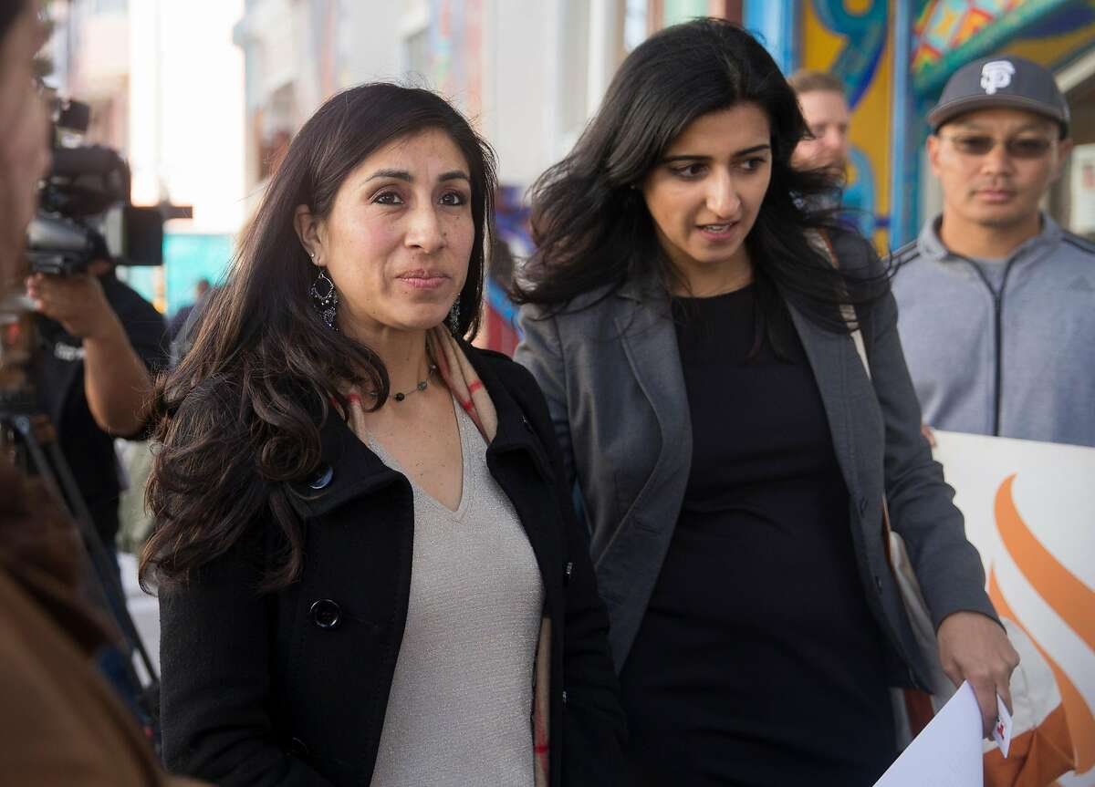 Dora Mejia, left, and her attorney, Saira Hussain with Advancing Justice and Asian Law Caucus arrive at a press conference announcing a settlement reached made between San Francisco Police Department and Dora Mejia outside the Women's Building Thursday, March 8, 2018 in San Francisco, Calif.
