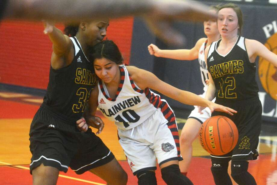 Plainview point guard Kristan Rincon, 10, dribbles into Amarillo High's Zayla Tinner during a District 3-5A game this season. Rincon was voted to the all-district first team. Tinner was the district's Most Valuable Player. Photo: Skip Leon/Plainview Herald