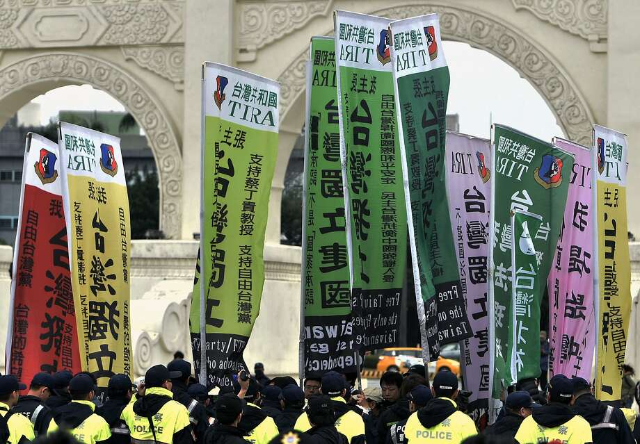 Pro-Taiwan independence activists protest last year. Taiwan has built a vibrant economy and independent political system despite threats from China. Photo: SAM YEH, AFP/Getty Images