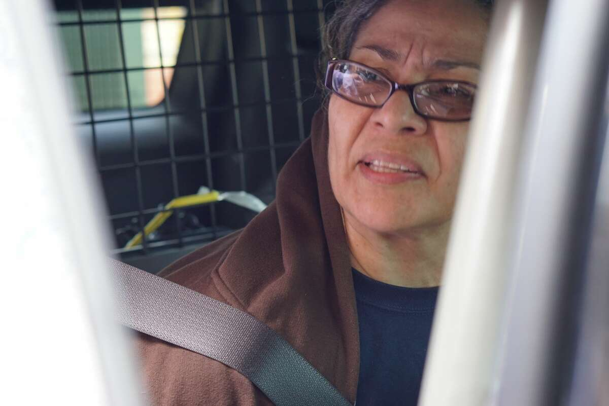 Gabriella De Arroyo, 59, was escorted by deputies to a Bexar County Sheriff's Office vehicle Thursday, March 8, 2018. Arroyo faces a third-degree felony charge of escaping from a correctional facility for her alleged roll in aiding three inmates prior to their escape, according to the Sheriff's Office.