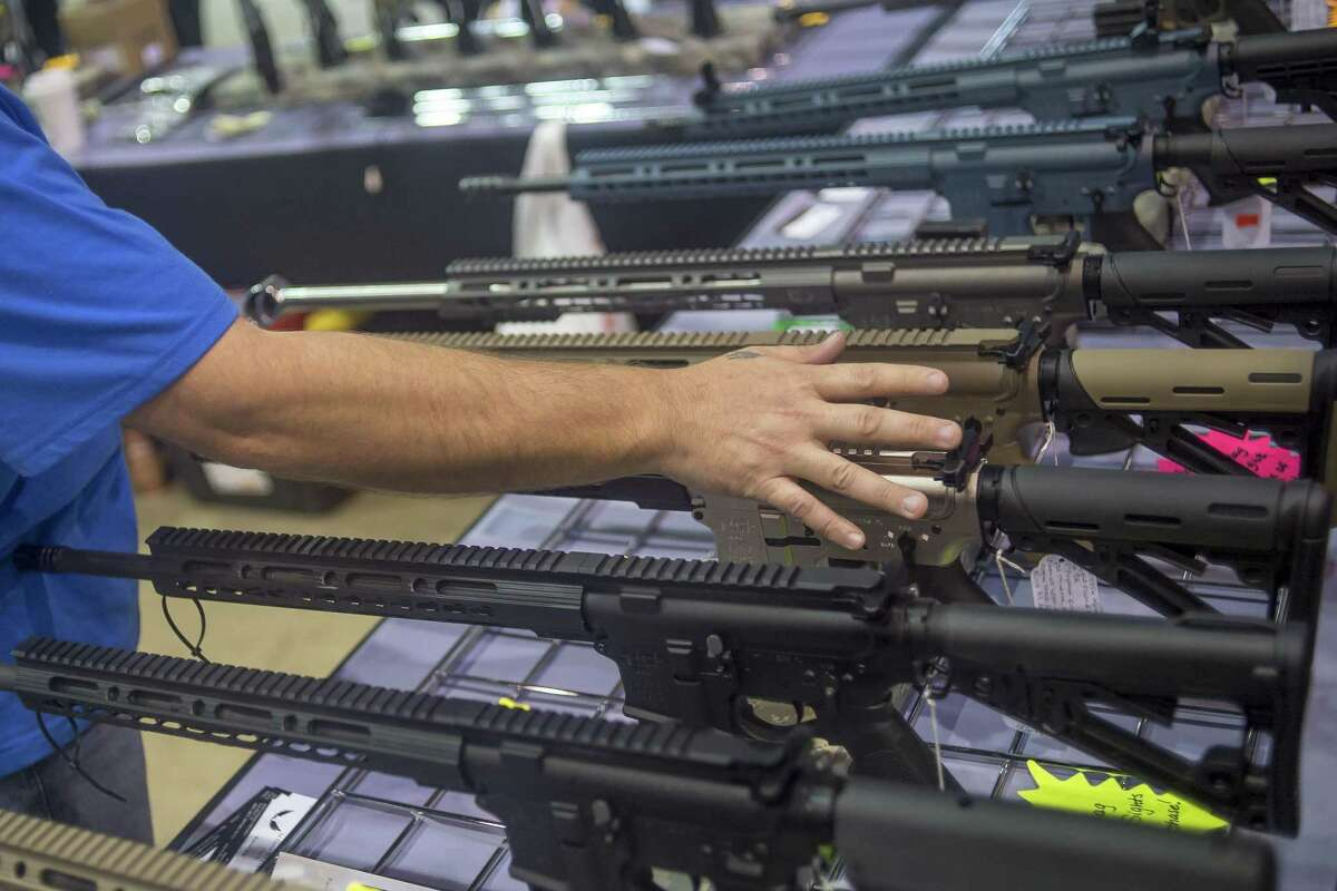 Rows of AR-15 style rifles were on display at the Florida Gun Show in Tampa, Fla., Feb. 25, 2018. (Zack Wittman/The New York Times)