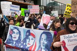 Hundreds of protesters gather outside the Sawyer Hotel Wednesday, March 7, 2018 in Sacramento, Calif. as U.S. Attorney General Jeff Sessions makes an announcement and speech regarding sanctuary jurisdictions.