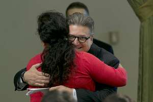 FILE  - In this Aug. 31, 2017 file photo, State Sen. Bob Hertzberg, D-Van Nuys, hugs Assemblywoman Lorena Gonzalez Fletcher, D-San Diego, after his storm water bill was approved by the Assembly in Sacramento, Calif. Hertzberg has been told to stop hugging people after a sexual misconduct investigation concluded his behavior made multiple colleagues uncomfortable. Hertzberg was formally reprimanded Tuesday, March 6, 2018, by the Senate Rules Committee. The Los Angeles-area says he will respect the request not to hug people. (AP Photo/Rich Pedroncelli, File)