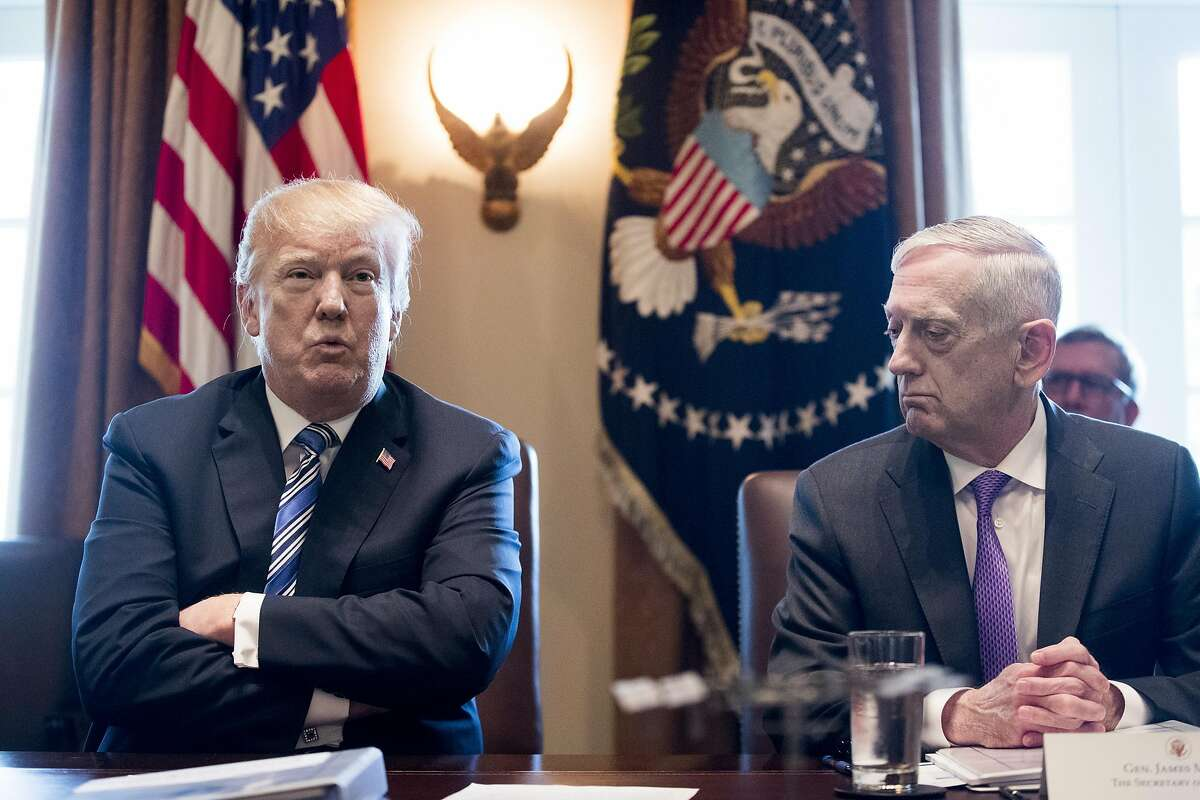 WASHINGTON, DC - MARCH 8: (AFP OUT) US President Donald J. Trump (L) speaks beside US Secretary of Defense Jim Mattis (R) during a meeting with members of his Cabinet, in the Cabinet Room of the White House March 8, 2018 in Washington, DC, (Photo by Michael Reynolds-Pool/Getty Images)