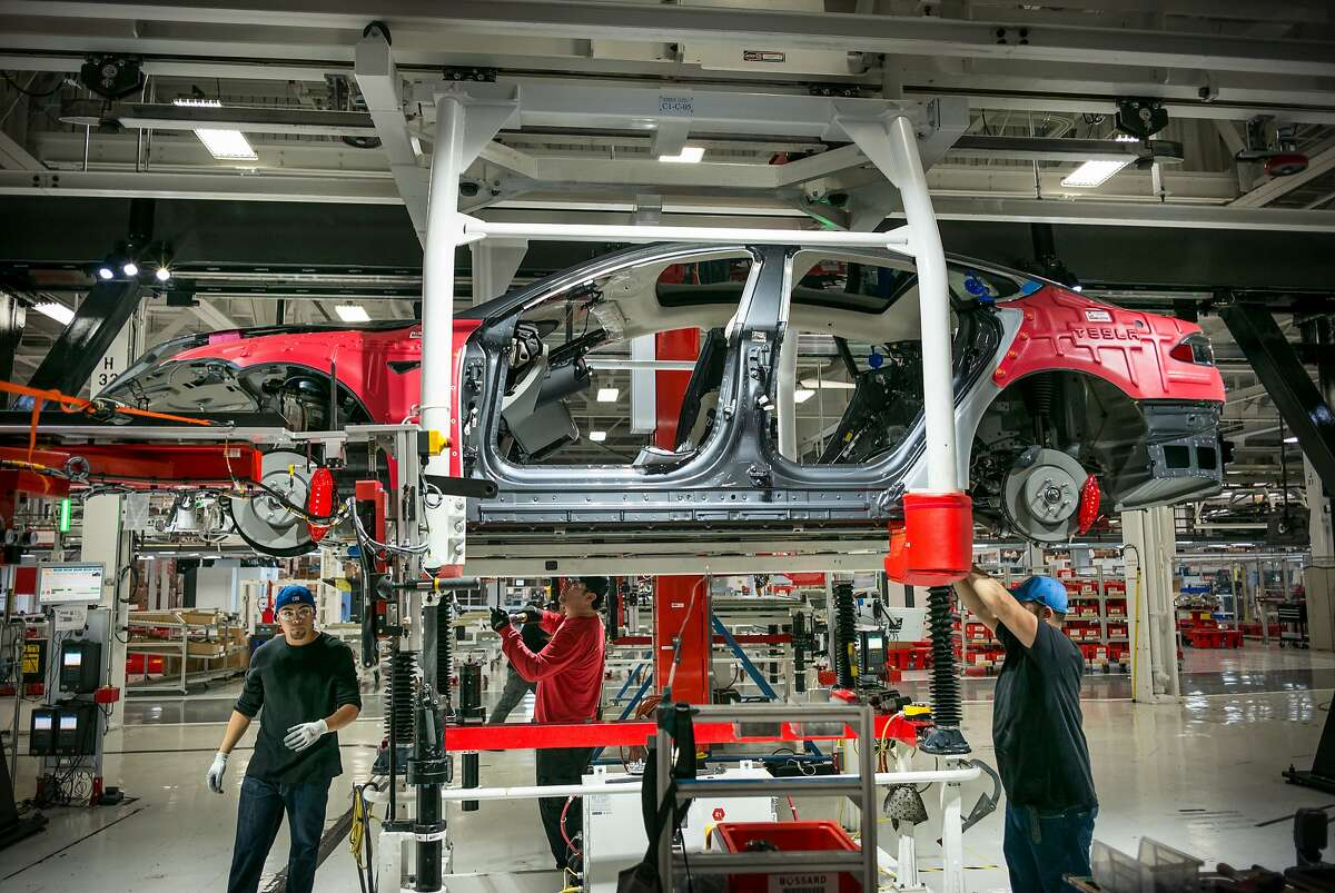 Workers assemble cars on the line at Tesla's factory in Fremont. Tesla reportedly announced in an internal company email Friday, June 19, that workers could take the day off to observe Juneteenth, but some employees has already shown up for their shifts when they got the news.