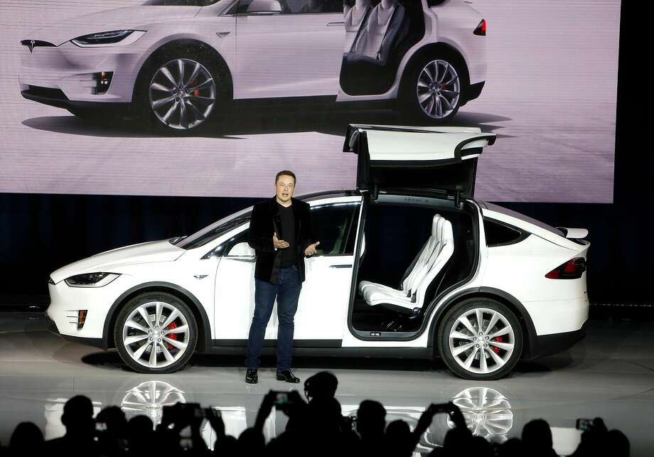"""FIEL-- Elon Musk introduces Tesla's electric SUV, the Model X in Fremont on Tuesday, Sept. 29, 2015. Musk was riled by a Robert W. Baird analyst report that said """"increasingly immaterial"""" headlines were dominating Tesla news cycles. Photo: Scott Strazzante / The Chronicle 2015"""