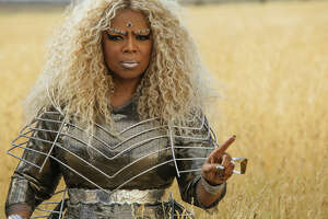 """This image released by Disney shows Oprah Winfrey in a scene from """"A Wrinkle In Time."""" (Atsushi Nishijima/Disney via AP)"""
