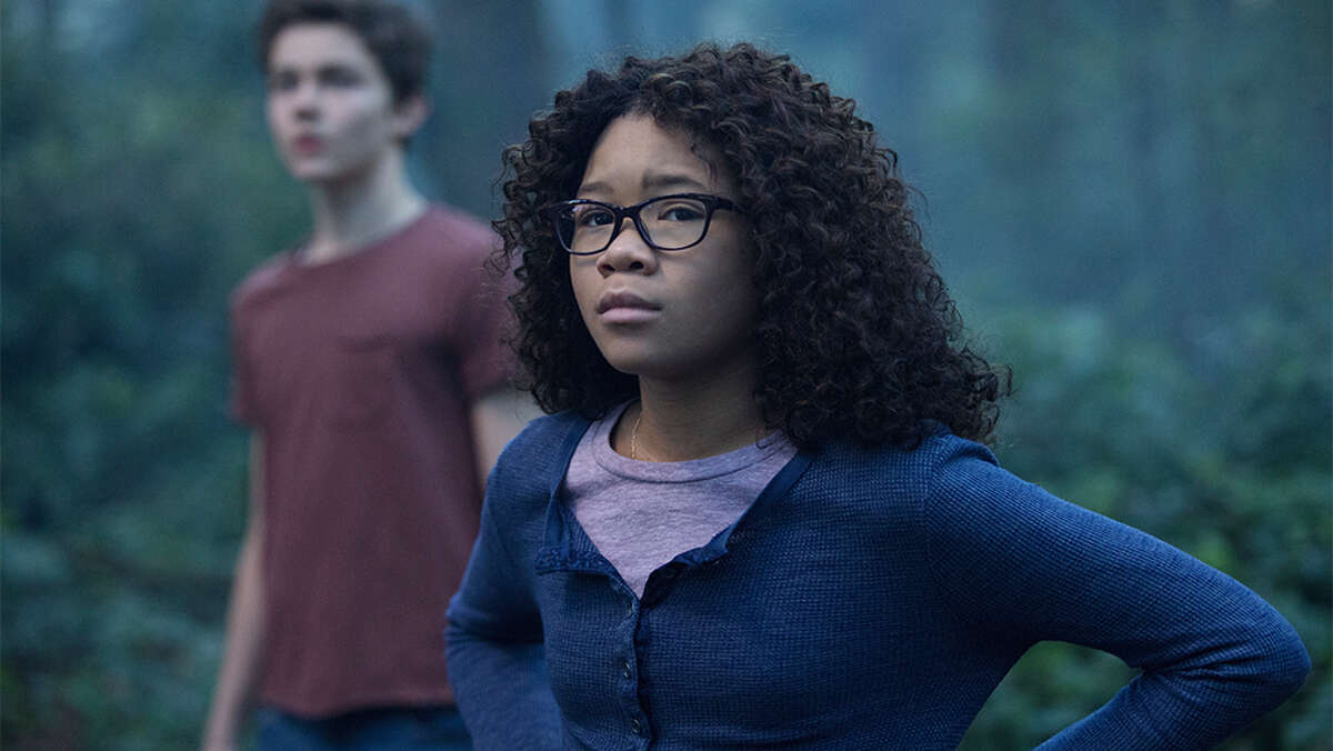 Storm Reid is Meg Murry and Levi Miller is Calvin O'Keefe in Disney's A WRINKLE IN TIME.