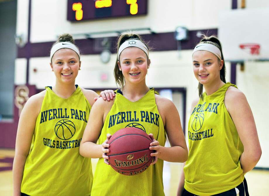 Averill Park girls' basketball stars and sisters, from left, senior Mallory Wood, 8th grader Amelia Wood and sophomore Kelsey Wood Tuesday March 6, 2018 in Colonie, NY.  (John Carl D'Annibale/Times Union) Photo: John Carl D'Annibale / 20043132A