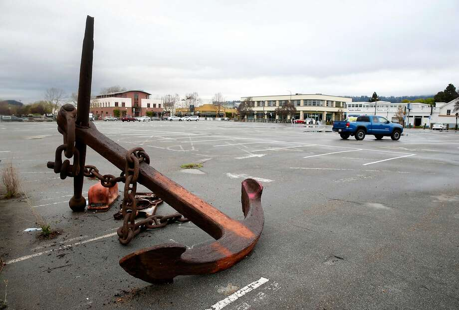 A rusty anchor sits in the back of a Berkeley parking lot where a housing complex, debated for five years, is planned. Photo: Paul Chinn, The Chronicle