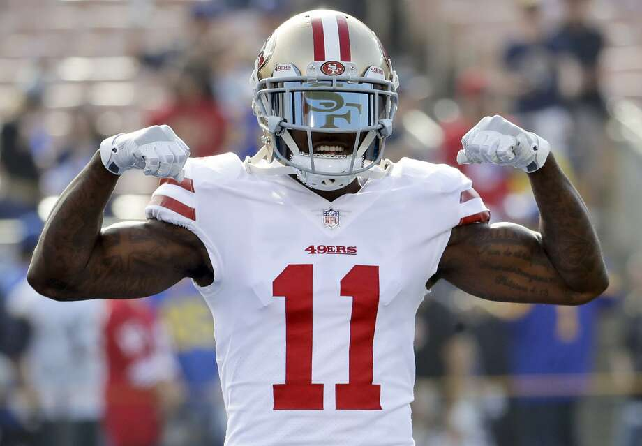 FILE - In this Dec. 31, 2017, file photo, San Francisco 49ers wide receiver Marquise Goodwin gestures as he comes onto the field before an NFL football game against the Los Angeles Rams, Sunday,, in Los Angeles. The 49ers have signed Goodwin to a three-year contract extension, Thursday, March 8, 2018. NFL Network reported that Goodwin's new contract is worth $20.3 million with $10 million in guarantees. (AP Photo/Rick Scuteri, File) Photo: Rick Scuteri, Associated Press