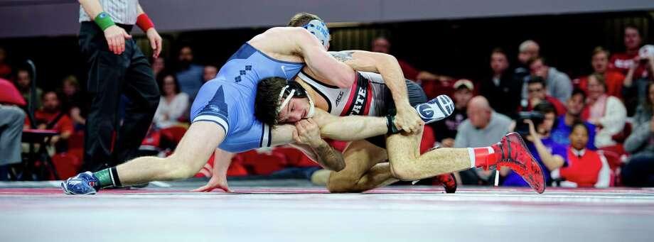 Former Danbury High School wrestler Kevin Jack, right, in action for North Carolina State University. Photo: Photo Courtesy Of N.C. State Athletics / Photo Courtesy Of N.C. State Athletics / ©2018 - Greg Mintel