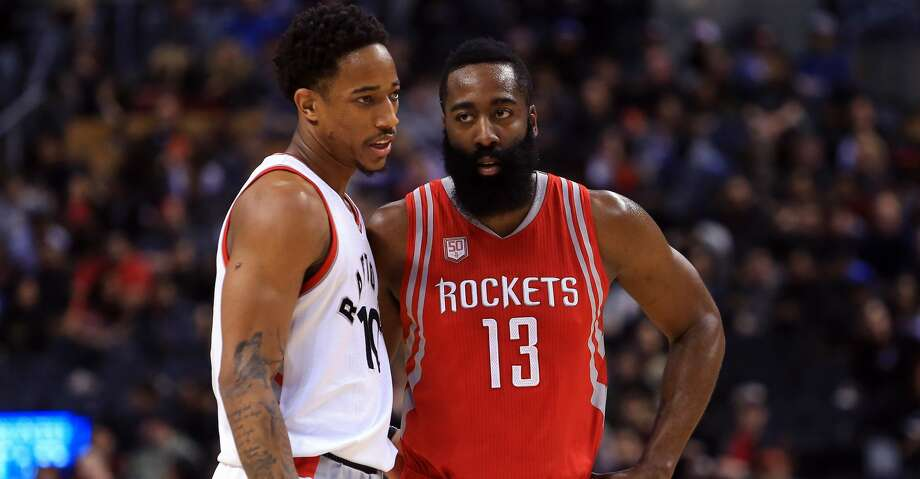 TORONTO, ON - JANUARY 8:  James Harden #13 of the Houston Rockets chats with DeMar DeRozan #10 of the Toronto Raptors during the first half of an NBA game at Air Canada Centre on January 8, 2017 in Toronto, Canada.  NOTE TO USER: User expressly acknowledges and agrees that, by downloading and or using this photograph, User is consenting to the terms and conditions of the Getty Images License Agreement.  (Photo by Vaughn Ridley/Getty Images) Photo: Vaughn Ridley/Getty Images