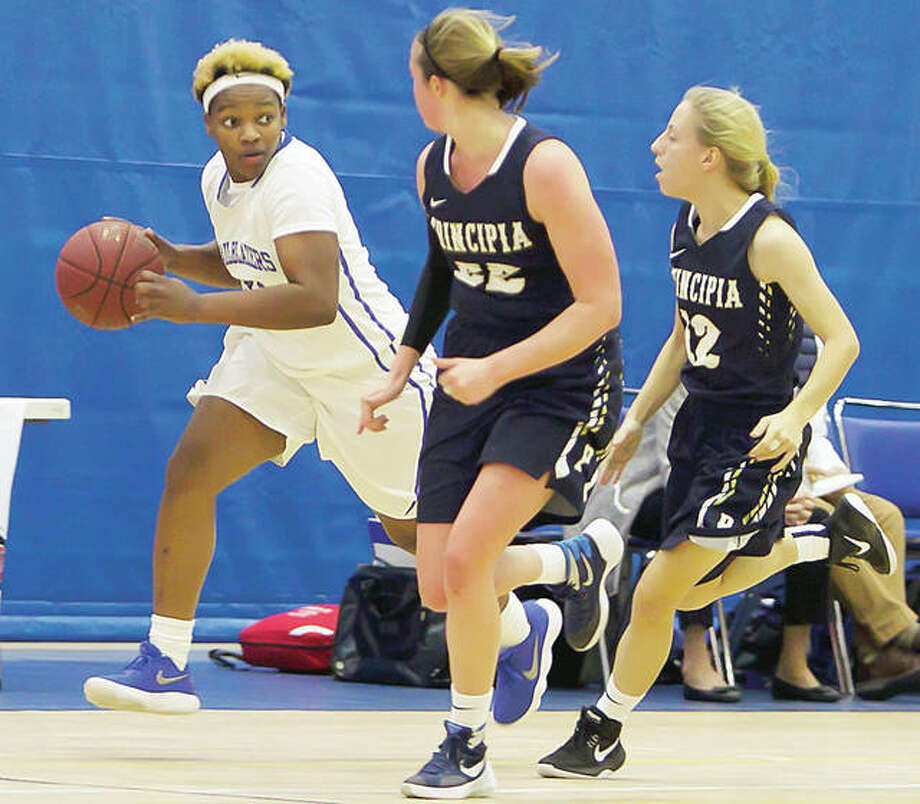 Juantia Walton of Lewis and Clark left, and her teammates will face Illinois Central College in a Region 24 Division II Tournament quarterfinal game at 2 p.m. Friday at Lincoln Land Community College in Springfield. Photo: LCCC Athletics
