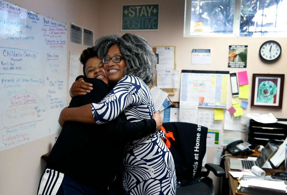 Student Danesha Johnson (left) gets a big hug from Workforce Development Director Aubria Lamendola at the Life Learning Academy charter school on Treasure Island. The school is breaking ground Friday on a dormitory that will house 20 students. Photo: Paul Chinn, The Chronicle