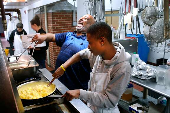 Charles Boomer, a student mentor and counselor, prepares lunch for students and faculty, with culinary class student Tre Jones (right) at the Life Learning Academy charter school on Treasure Island in San Francisco, Calif. on Tuesday, March 6, 2018. The school is breaking ground on a dormitory on Friday that will house 20 students.