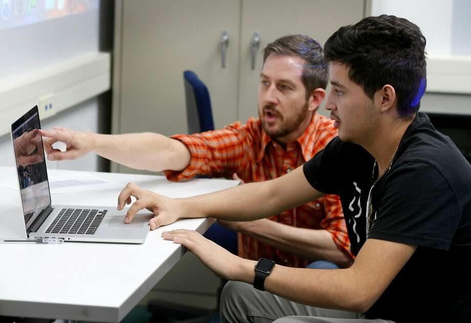 Andy Bydalek helps student Efren Delao learn Photoshop in a media arts class at the Life Learning Academy charter school on Treasure Island. Photo: Paul Chinn, The Chronicle