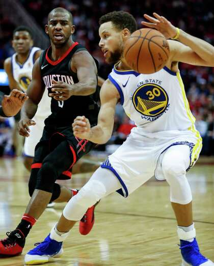 30d2d1cf4c1 Houston Rockets guard Chris Paul (3) defends against Golden State Warriors  guard Stephen Curry (30) during the fourth quarter of an NBA basketball  game at ...