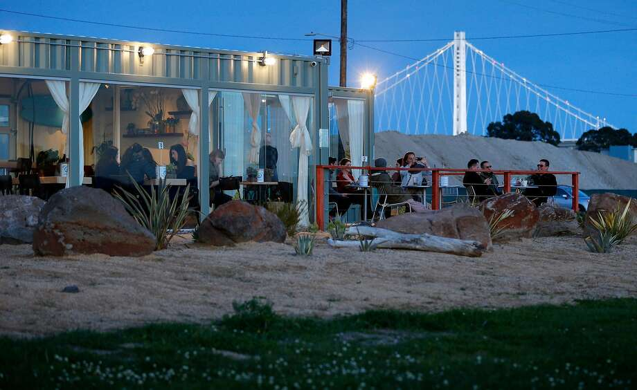 The indoor and outdoor seating area at MerSea Restaurant on Treasure Island in San Francisco, Calif., on Monday, March 5, 2018. MerSea is a new restaurant  (made from shipping containers) on Treasure Island with a spectacular view of the city. Photo: Carlos Avila Gonzalez / The Chronicle