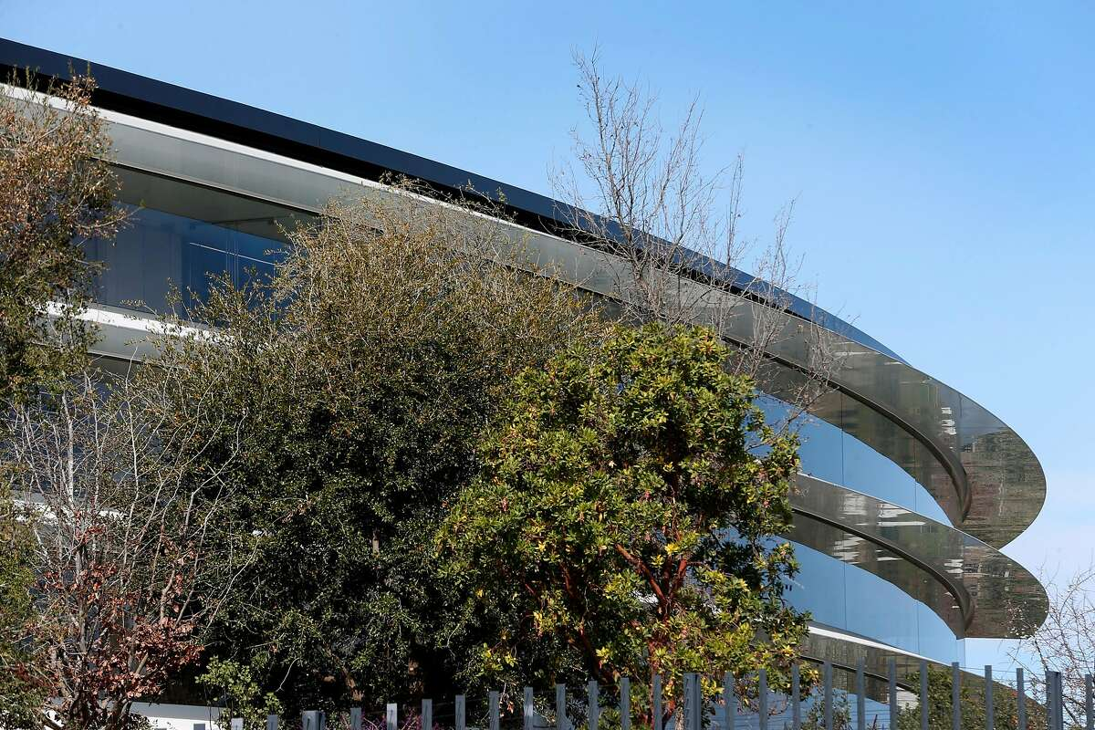 The circular Apple Park headquarters building is visible from the sidewalk in Cupertino, Calif. on Tuesday, Feb. 20, 2018.